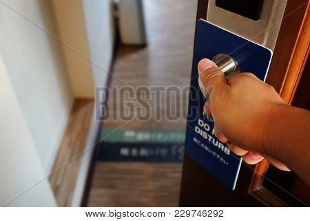 Closing The Door From The Room With The Sign, Do Not Disturb, In The Hotel