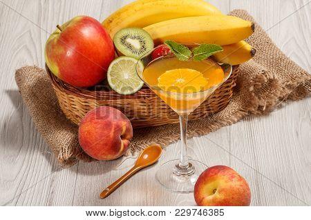 Orange Jelly In The Glass Topped Mint Leaves, Fresh Strawberries, Nectarine, Lime, Kiwi, Banana, App