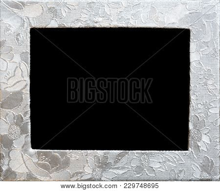 Silver Flower Embossing. Floral Decorative Metallic Frame. Foil With Pattern Of Flowers