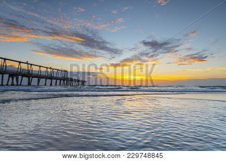 Southport Spit Sand Pumping Jetty And Incoming Tide On A Colourful Sunrise Morning