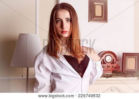 Sexy Woman Unbuttoned Blouse Revealing Her Bra.