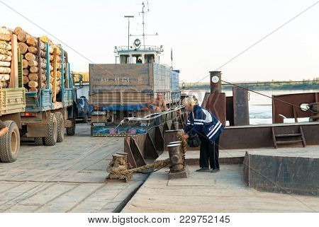 Near Malmyzh, Russia - September 3, 2009: The Female Cashier Unmoors For Departure Of The Loaded Fer