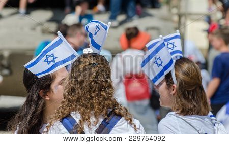 Latrun, Israel - May 02, 2017: The Patriotic Girl With Israeli Flag On His Head Celebrate Israel Ind