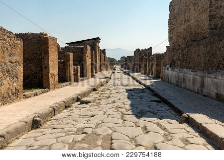 An Ancient Cobbled Street In The Ruins Of Pompeii, Italy.