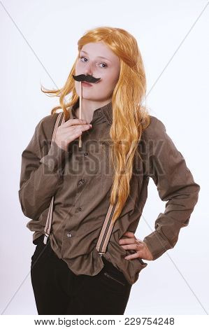 Crossdressing Young Woman With Fake Moustache Dressed Up As A Man