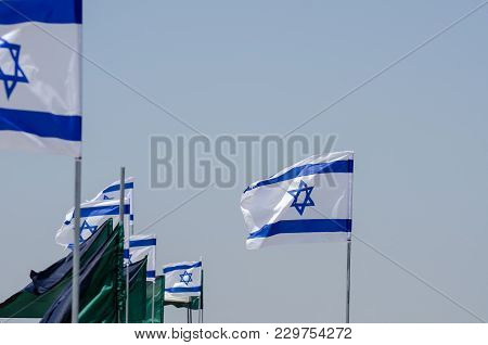 The Israeli Flags In Blue Sky At Israeli Independence Day