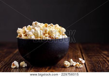 A Dark, Elegant Ceramic Bowl With Seductive Popcorn.