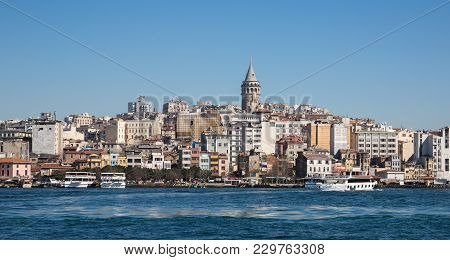 Galata Tower In Istanbul Against Blue Sky