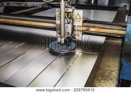 Cnc Laser Plasma Cutter. Modern Metalworking Technology At Manufacturing Plant Or Factory, Toned