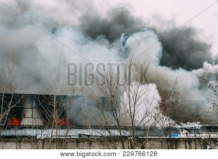 Fire And Strong Smoke In Burning Industrial Building
