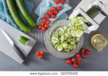 spiralizing cucumber vegetable with spiralizer