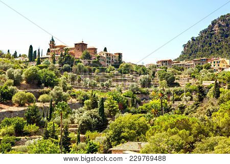 View On City Valldemossa With Traditional Flower Decoration, Famous Old Mediterranean Village Of Maj