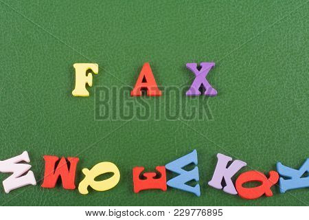 Word On Green Background Composed From Colorful Abc Alphabet Block Wooden Letters, Copy Space For Ad