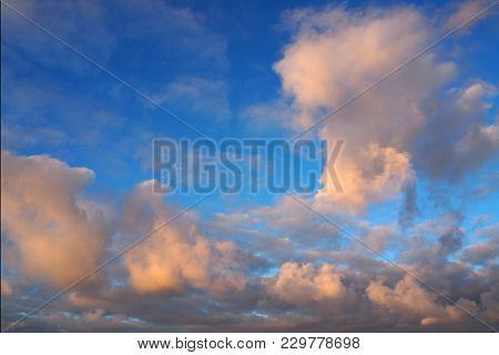 Sunny Cloudy Sky At Sunset. A Scene Of Sunlit Clouds.