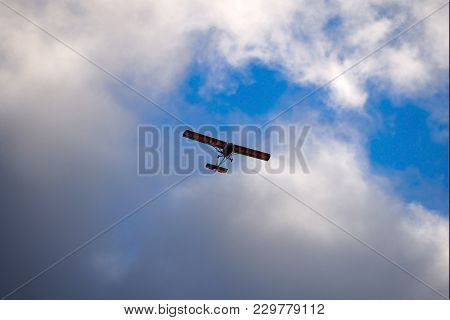 Light-engine Aircraft In The Cloudy Sky. Ultralight Aviation Is An Extreme Sport.