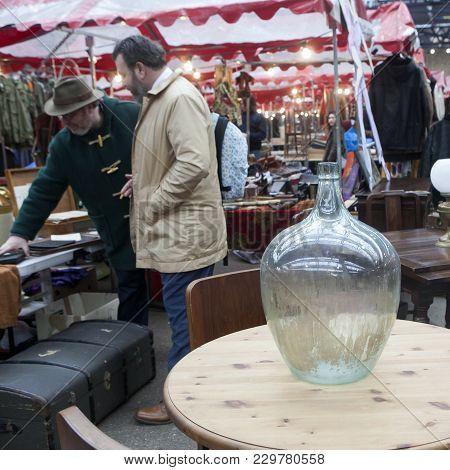 London, Uk - July 17, 2016. Spitalfields Antic Market. Old Bottles And Pharmacy Jars On A Wooden Che