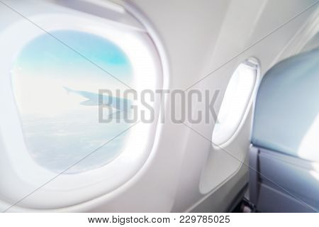 Airplane Window View Inside An Aircraft. Window Plane. Vacation Destinations Concept. Light Blue Sea