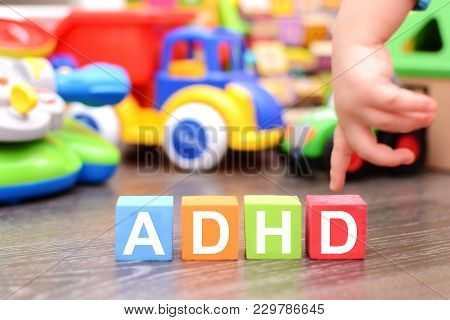 Attention Deficit Hyperactivity Disorder Or Adhd Concept With Toddler Hand Touching Colored Cubes Ag