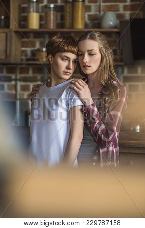 Beautiful Young Lesbian Couple On Kitchen At Home