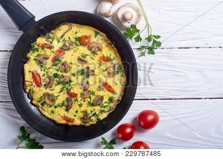 Omelette With Mushroom , Tomatoes And Parsley . Food Background