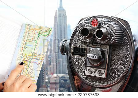 Traveler Holding City Map In Front Of A Famous Place