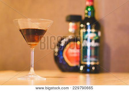 Glass Of Liquor On The Background Of Bottles