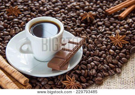 Fried Coffee Beans With A Cup On A Saucer With An Espresso Drink With Cinnamon And Anise And Milk Ch