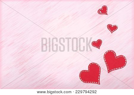 Red Paper Hearts On Pink Background. Valentine's Day. Copy Space. Top View.