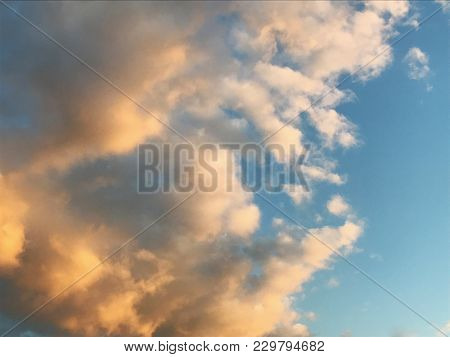 Pretty, Fluffy Clouds At Sunset In Spring.