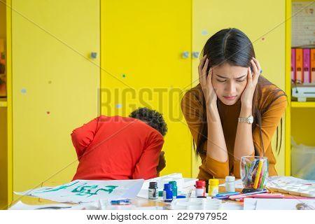Teacher Get Headache With Two Naughty Kids In Classroom At Kindergarten School