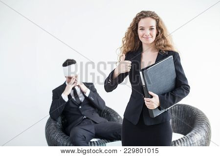 Beautiful Young Business Woman Holding Folder Or Document File  And And Thumb Up With Business Man A