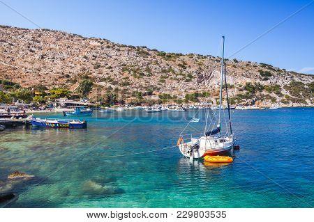 Zakynthos, Greece - August 20, 2016: Sailing Yachts Moored In Agios Nikolaos Bay. Zakynthos, Greek R