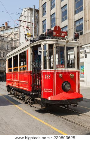 Istanbul, Turkey - July 1, 2016: Traditional Red Tram Goes On Istiklal Street In Istanbul, Popular P