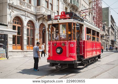Istanbul, Turkey - July 1, 2016: Traditional Red Tram On Istiklal Street In Istanbul, Popular Public