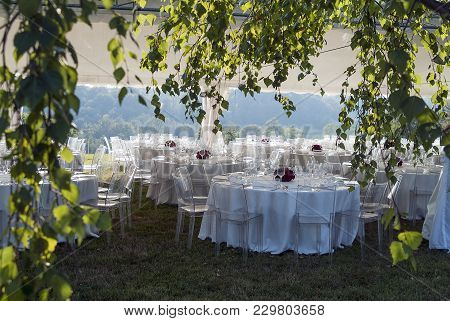 Tent With Set Tables For Outdoor Wedding Banquet