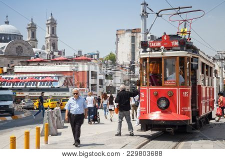 Istanbul, Turkey - July 1, 2016: Traditional Red Tram On Taksim Square In Istanbul, Popular Public A