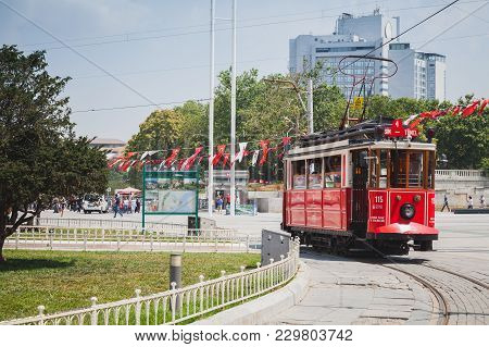 Istanbul, Turkey - July 1, 2016: Traditional Red Tram Goes On Taksim Square In Istanbul, Popular Pub