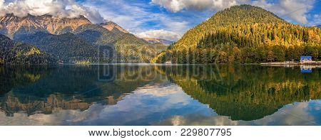 Autumn Panorama Of The Mountain Lake Riza. Abkhazia