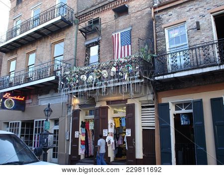Store Front Shop On Bourbon Street In French Quarter Selling Mardi Gras Themed Apparel, New Orleans,