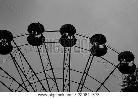 Silhouette Of A Ferris Wheel In The Dusk