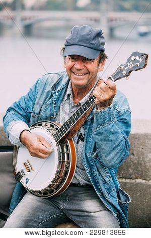 Prague, Czech Republic - October 10, 2014: Street Busker Performing Jazz Songs At The Charles Bridge