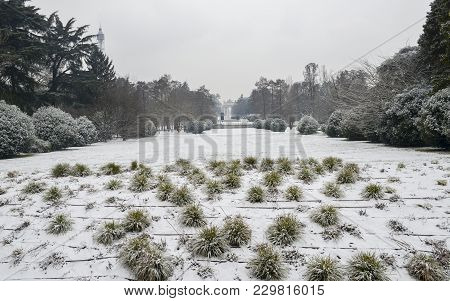 Parco Sempione In Milan, Lombardy, Italy Covered In Snow. Arco Della Pace, Translated To Peace Arch,