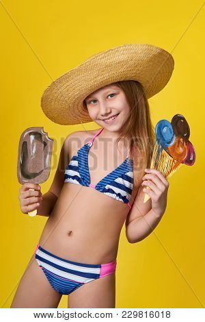 Cute Girl Wearing Swimsuit Holds In Hand Image Ice Cream. Cheerful Young Woman Teenager Loves Summer