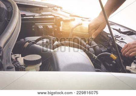 Man Hold The Oil Check Car Before Departure For Safety.