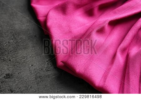 Synthetic textile on dark background. Fabric texture