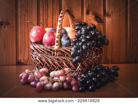 Fresh Ripe Fruits In Basket. Selective Focus.