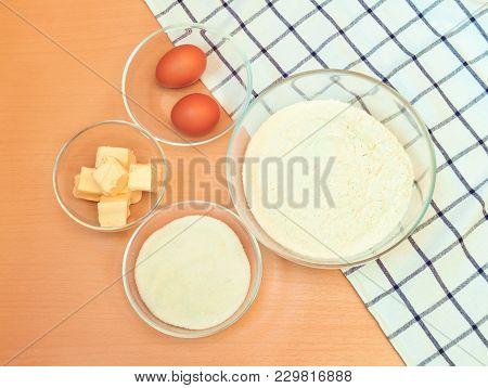 Flour, Eggs, Sugar, Butter To Make Cake. Top View.