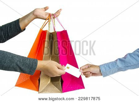 Customer Paying For Their Order With A Credit Card In Shopping Mall. Seller Holding A Shopping Bag A