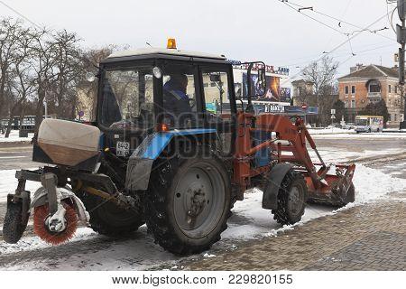Evpatoria, Crimea, Russia - February 28, 2018: Tractor Clears Snow On Theater Square In Evpatoria, C