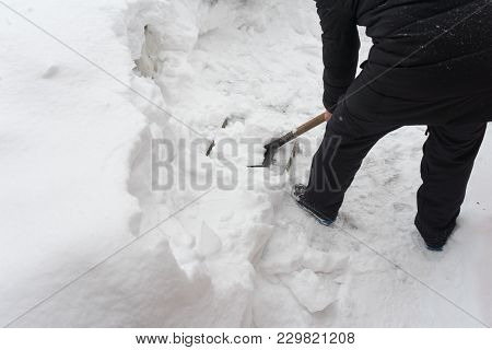 Remove Snow With A Shovel. Place For Your Text...
